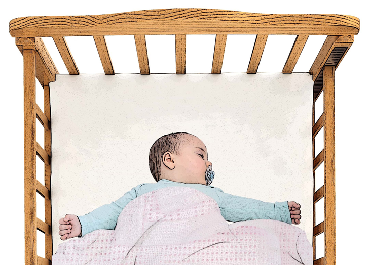 Baby in cot with a cellular blanket