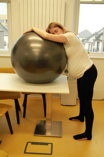 Resting on a birthing ball